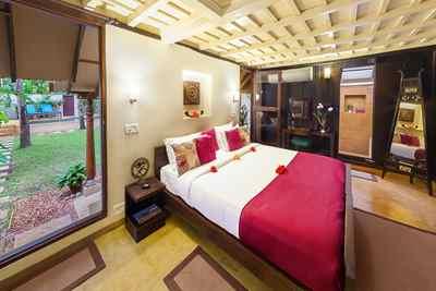 Schlafzimmer im Hibiscus-Bungalow im Marari Beach