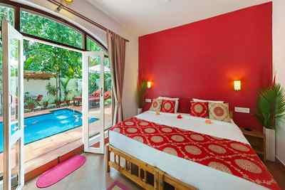 Schlafzimmer im Orchid-Bungalow im Marari Beach