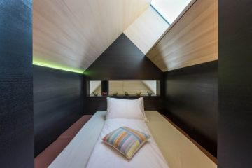 Bett unter dem Giebel