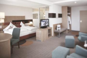 Suite mit Bett und Wohnbereich